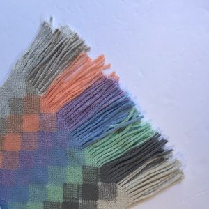 Pretty multicolored scarf with fringe at bottom